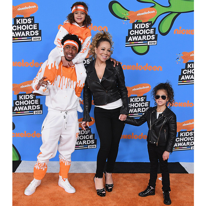 Friendly exes! Nick Cannon and Mariah Carey arrived at the Nickelodeon Kid's Choice Awards with their mini-mes - twins Moroccan and Monroe! Like last year, Mariah matched her daughter in black pants and leather jackets while Nick and his little boy were twinning in white and orange sweat suits. The former couple split in 2016 but they maintain that they're still the best of  friends.