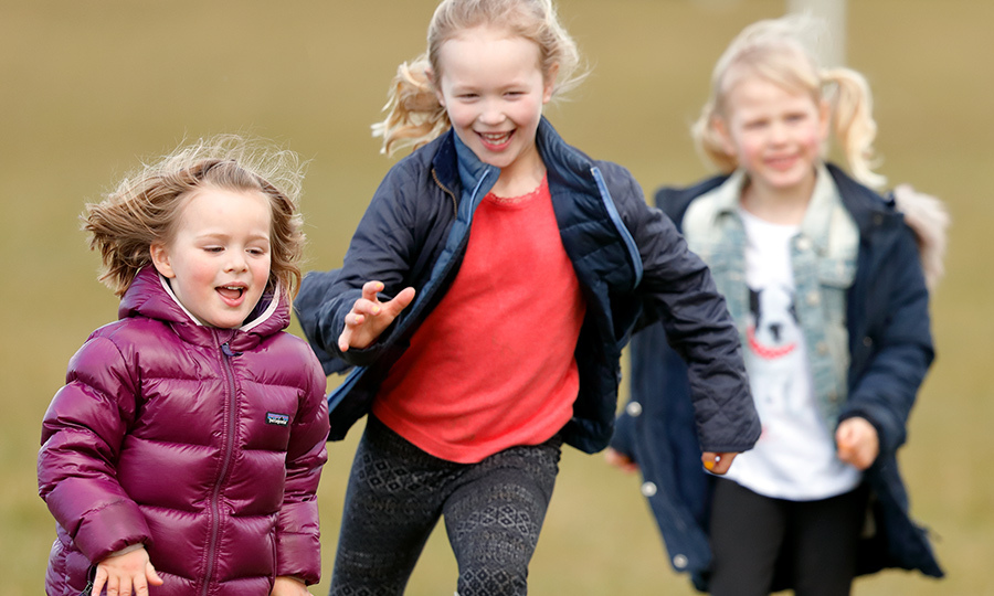 <p>Mia's cousins Isla and Savannah Phillips chased the little girl around during some fun playtime at the horse trials.</p>