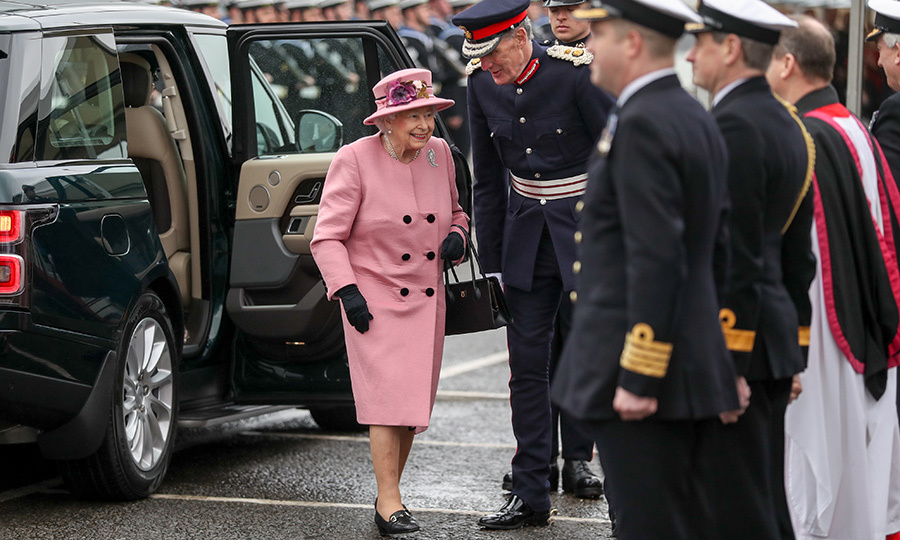 <p>Queen Elizabeth was pretty in pink for the ceremony in Plymouth, England!</p>