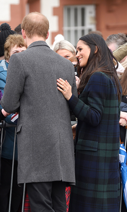 <p>Meghan watched on as her husband-to-be graciously chatted with royal fans, all the while keeping a supportive hand on his back.</p>