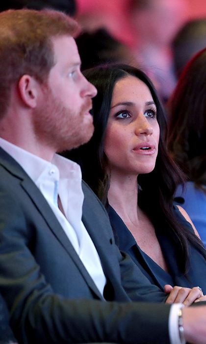 <p>Meghan has never been afraid of showing a little PDA, delicately placing her hand on her royal love's arm.</p>