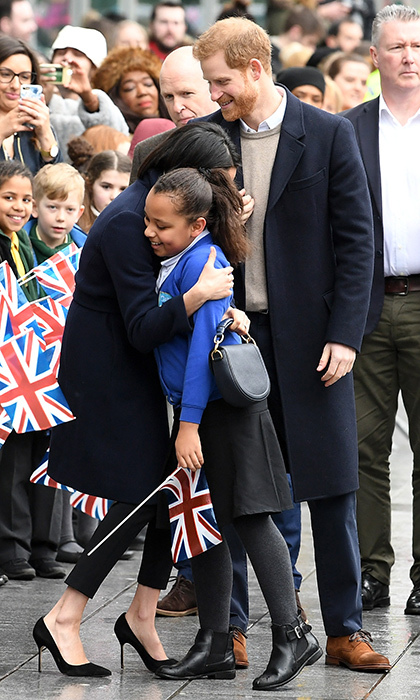 <p>Hugs all around! Prince Harry made sure this little aspiring actress got to meet one of her biggest role models.</p>