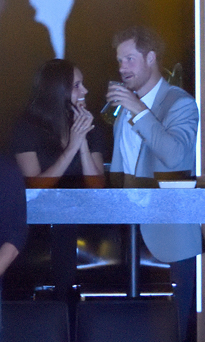 <p>Meghan smiled lovingly at her famous boyfriend while at the Invictus Games closing ceremony.</p>