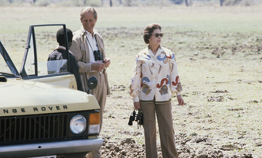<p>A rare photo of the Queen in beige trousers during a safari with Prince Phillip in 1979. The couple were on a state visit to Zambia.