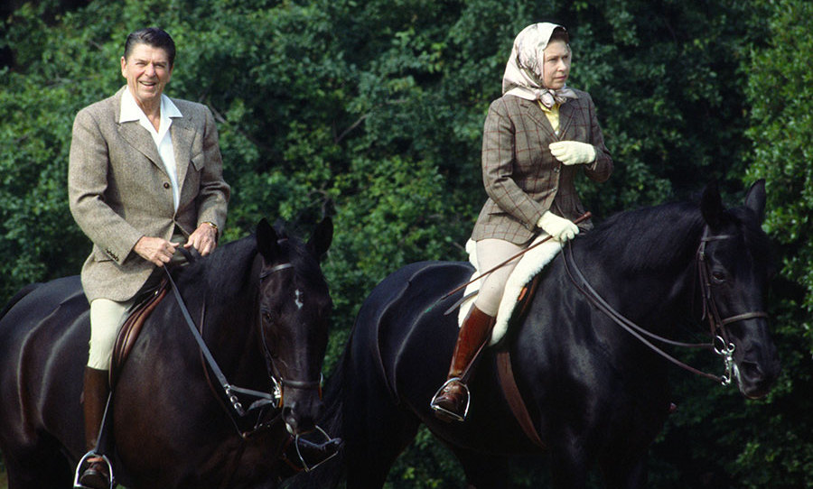 <p>The Queen is known for her love of horse riding. Here she is in 1982 wearing jodhpurs while riding her horse Burmese in Windsor Great Park with late US President <strong>Ronald Reagan</strong>.</p>