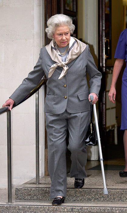 <p>This may be the only time we've seen the Queen wear a trouser suit. She looked smart in the grey two-piece when leaving hospital in 2003. Her Majesty had an injured knee and was possibly dressing to cover it.