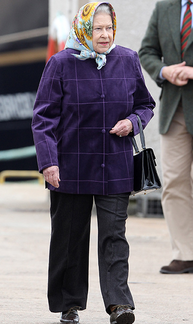 <p>Her Majesty chose black trousers and a purple coat as she disembarked the Hebridean Princess after a cruise with the royal family in 2010.