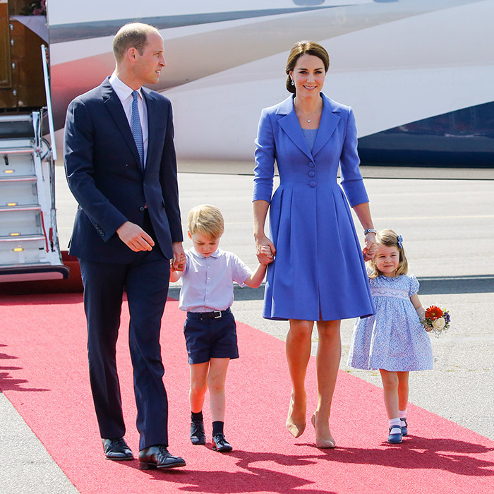 On day one of the German visit on July 19, 2017, William, Kate, George and Charlotte stepped off the plane in Berlin well in sync wearing various shades of blue - with Mom Kate wearing a coat dress by Catherine Walker. The fact that little Charlotte was clutching a tiny bouquet sent the cute factor sky high!