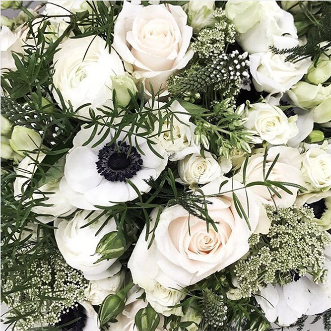 Up close and personal with a striking green and white arrangement brimming with spring blooms.
