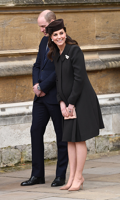 "Kate made a surprise appearance at the Royal Family's annual Easter outing to take in the service at St George's Chapel in Windsor, where Prince Harry and Meghan will say ""I do."" The royal, then eight months pregnant, wore a chocolate brown Catherine Walker coat that perfectly skimmed her bump along with nude accessories and a matching brown hat. She topped the look off with pearl earrings and a pearl broach.