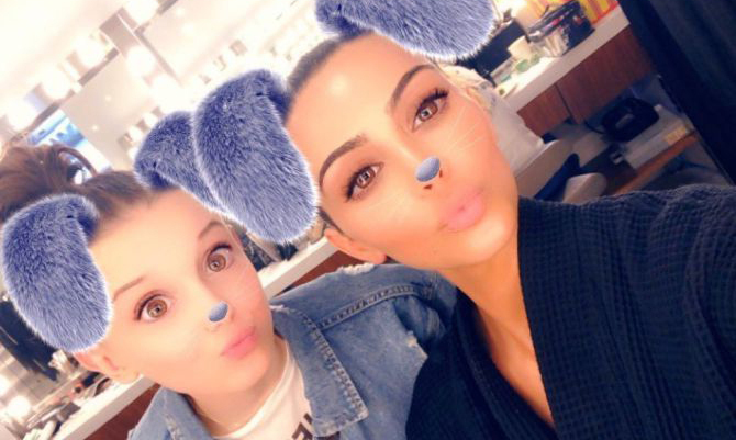 "Millie Bobby Brown finally met Kim Kardashian and she couldn't have been more excited! The 14-year-old took to her Snapchat to post photos with the reality mogul, one with a dog filter and another with the two stars wearing fire ball halos. The <em>Stranger Things</em> star has made no secret of her love for the Kardashian family, gushing about them on Jimmy Fallon in 2017. ""I love them. I love them!"" said Brown. ""I'm obsessed with them. I follow them on social media. I think that they are just really great, they are so entertaining."""