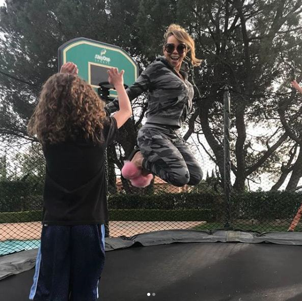 "<p>Hop hop! Mariah Carey channeled her inner bunny rabbit while playing on a trampoline with her 6-year-old son, Moroccan. The pop star wrote,""Me & demkids pon the trampoline ☺️ The Easter Bunny is about to come! "".</p>