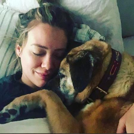 "<p>Hilary Duff knows how to chill! The star spent part of her Easter weekend snuggled up with her pup. ""Just two snuggly bugs,"" she said.</p>