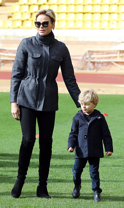 <p>Princess Charlene and Prince Jacques welcomed spring as they attended the International Rugby tournament Tournoi Sainte Devote at the Louis II Stadium in Monaco. Prince Albert's wife looked chic as per usual in a grey utility jacket, black pants and over-the-knee boots.</p>