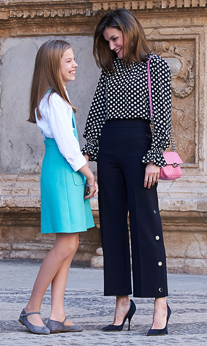 Meanwhile in Madrid, Queen Letizia of Spain was trendy in polka dots and cropped trousers as she joined the Spanish royal family – including daughter Princess Sofia – at Easter services. King Felipe's wife accessorized the look with a pink shoulder bag.