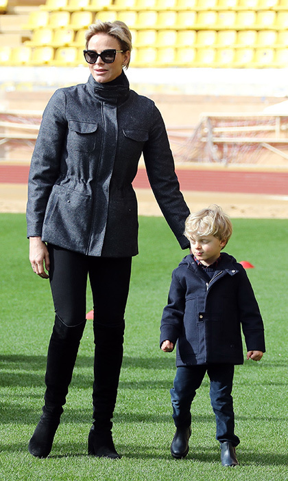 Meanwhile in Monaco, mom-of-two Princess Charlene went casual in a grey utility jacket and over-the-knee boots with an equally dressed-down Prince Jacques, three. Mother and son were attending the Tournoi Sainte Devote International Rugby tournament at the Louis II Stadium in Monaco.