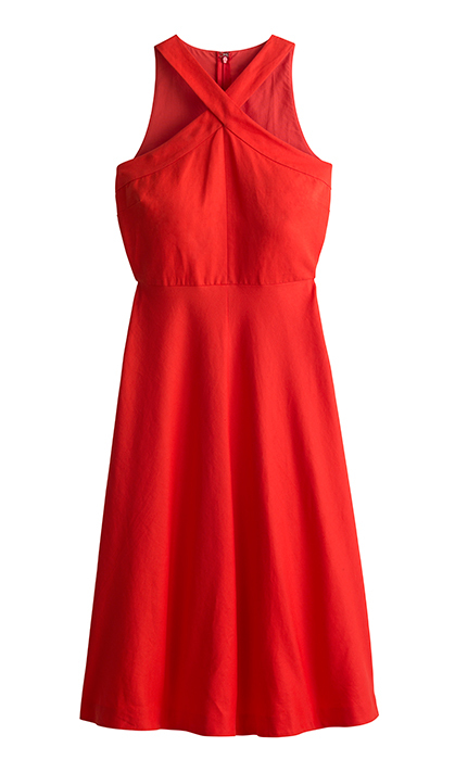 <p>The criss-cross neckline adds a sophisticated detail to an otherwise simple outfit. Wear it with some flashy bracelets and fun heels and dance the night away.</p>