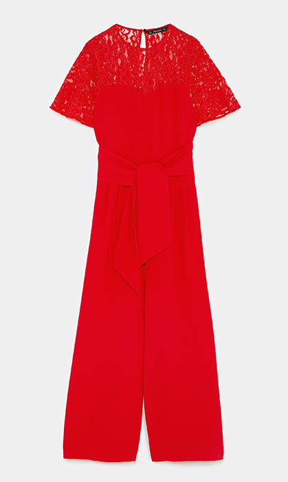 <p>The demure neckline and lacy detail combined with the fiery red hue means that this jumpsuit requires little to no accessorizing to stand out.</p>