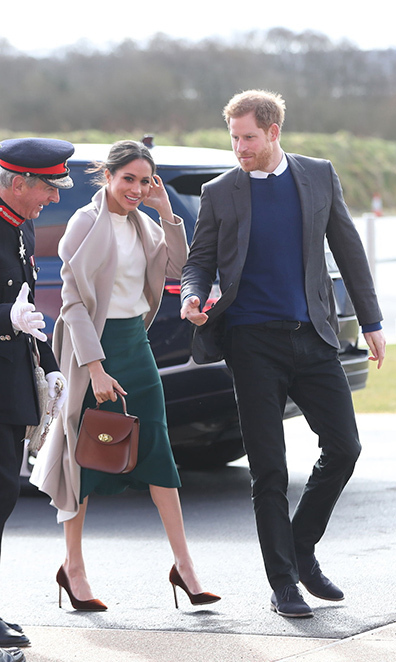 Meghan Markle and Prince Harry walking together in Ireland during a royal engagement in 2018