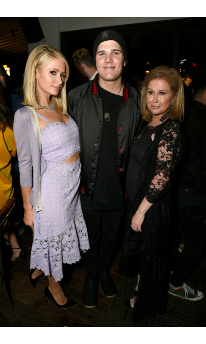 Hilton sandwich! The famous family was among guests to come out and support Paris for her big night. Seen here: Paris Hilton and her fiancé Chris Zylka, posed with Kathy Hilton.