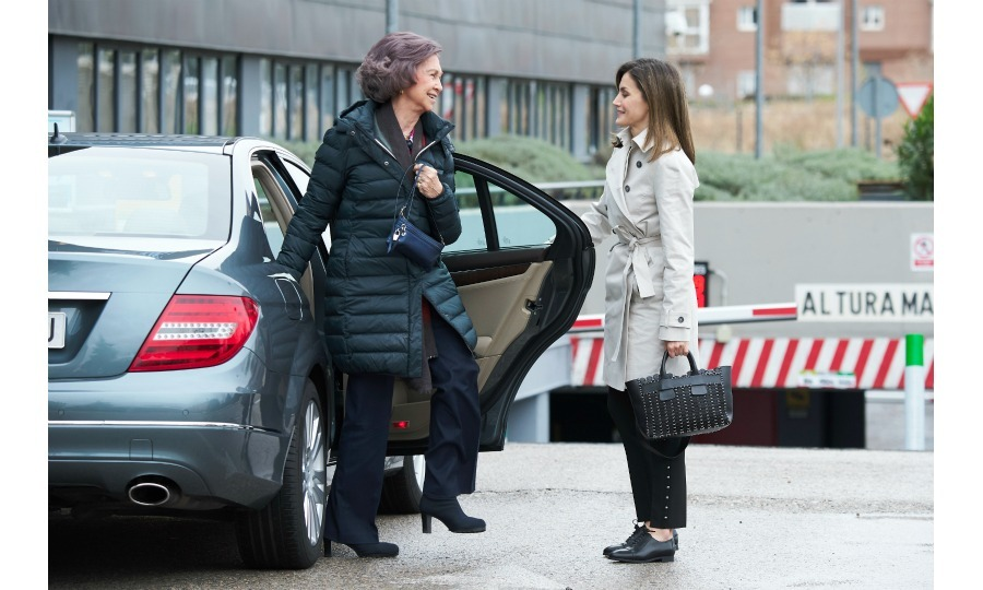 The 45-year-old former journalist was first seen sweetly holding the car door open for her 79-year-old mother-in-law. Letizia looked casually chic in a camel trench coat, black cropped pants and matching shoes. Sofía, who wore a black coat and also donned dark pants, thanked Letizia and grinned back at her. Meanwhile, the 50-year-old monarch looked stylish in gray jeans, a tailor sweater and a blue plaid jacket.