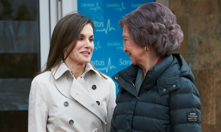 After a controversial Easter mass together, Queen Letizia and Queen Sofía of Spain have publicly reunited for the first time. The royal pair put on big smiles as they visited former King Juan Carlos at Sanitas La Moraleja University Hospital in Madrid on Saturday, April 7 after his successful knee surgery. Joining King Felipe, the powerful women seemed to be extra affectionate with each other as cameras snapped and rolled around them. The trio was spotted entering and exiting the hospital, stopping to pose for photos together. Letizia and Sofia were noticeably cordial to each other the entire time.
