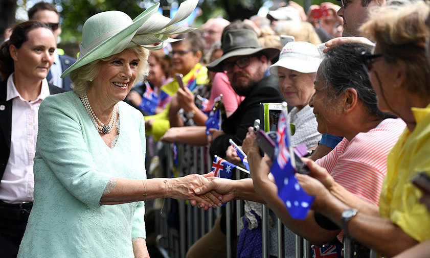 Duchess Camilla was all smiles as she was greeted by members of the public, who lined the streets with flowers and Australian flags during the royal visit to Brisbane. The Duchess was styled in a pastel dress with a matching hat and her signature multi-strand pearl necklace.