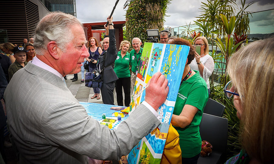 Prince Charles added some finishing touches to a children's painting during his official visit to the Lady Cilento Children's Hospital in Brisbane. The future monarch and his wife spent time meeting patients and partaking in tasks such as baking and painting.