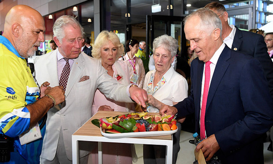 Time for a snack! Prince Charles and Duchess Camilla enjoyed a platter of local Australian fruit during their visit to the Athletes' Village with Prime Minister Malcolm Turnbull.