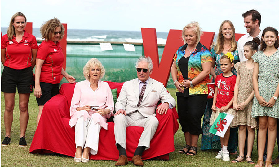 The royal pair met with a group of Welsh athletes on Broadbeach, Queensland. Prince Charles and Camilla appeared to be quite comfortable while taking a seat on the bright red couch set up outdoors.
