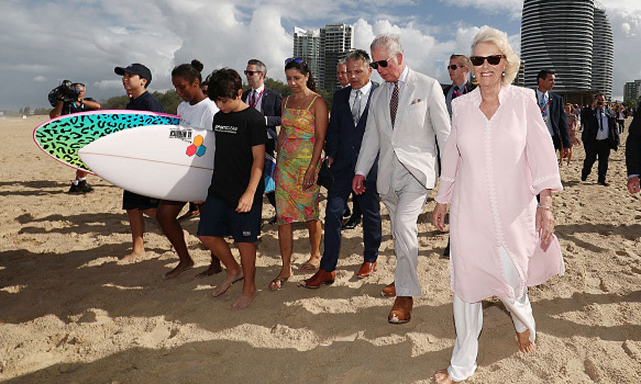 Prince Charles and Camilla, who went barefoot, took a stroll on Broadbeach. The royal couple was surrounded by a group of Gold Coast locals. Hundreds of families arrived at the beach early despite the rainy weather to catch a glimpse of the couple.