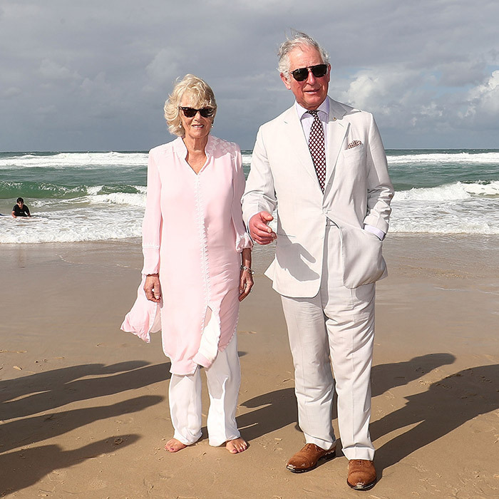 "After speaking to Prime Minister Malcolm Turnbull, the Prince of Wales and Duchess of Cornwall posed for photos along Broadbeach. The two enjoyed a walk along the Gold Coast, where Camilla took off her shoes to enjoy the beautiful beach and dip her toes in the water, although the Prince warned his wife: ""Don't go in, Darling."" Duchess Camilla wore a pastel pink kaftan and white trousers for what turned out to be a warm sunny outing after a brief downpour earlier in the day.
