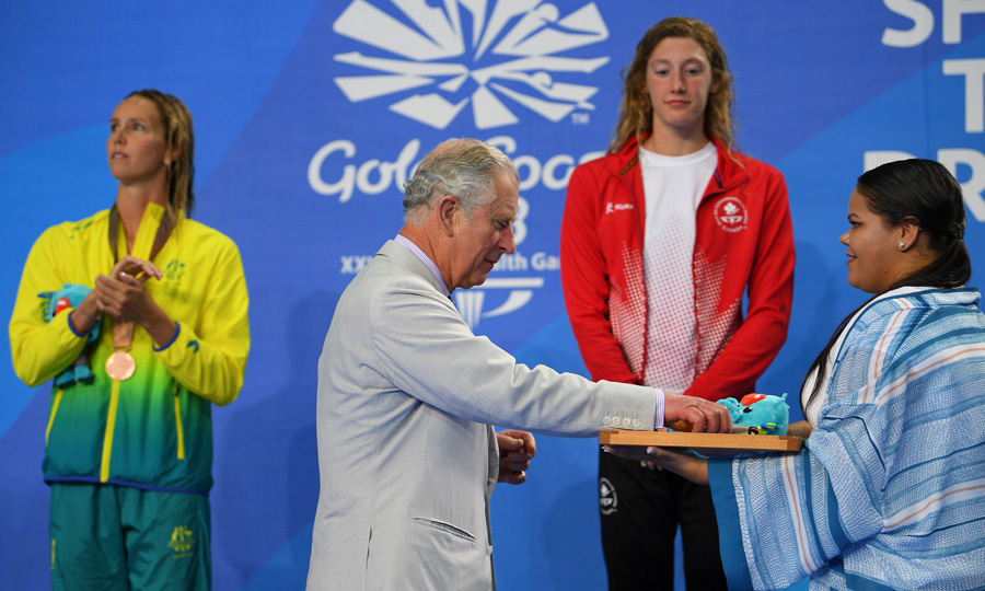 Queen Elizabeth's oldest son handed out the gold medals to Canada's Taylor Ruck after the swimming women's 200m freestyle final during the 2018 Gold Coast Commonwealth Games at the Optus Aquatic Centre.