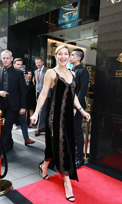 <p>Kate Hudson looked super glam in a velvet leopard print dress while attending the opening ceremony of Harry Winston store on April 10 in Hong Kong. The actress assisted in the ribbon cutting ceremony before enjoying a sip of champagne on the red carpet.</p>