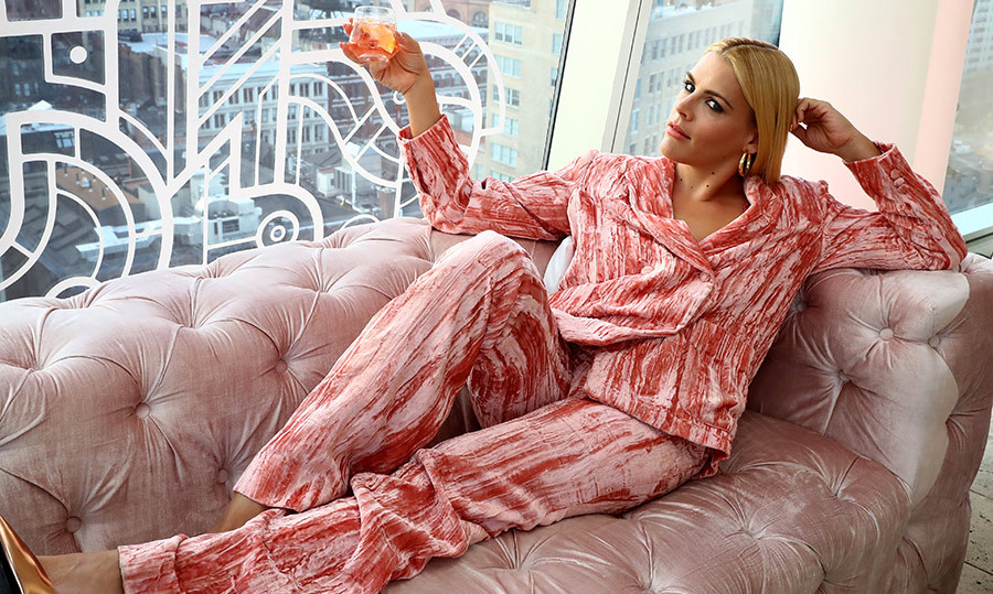 <p>Busy Philipps was the picture of chic in a full pink velvet suit. The <em>I Feel Pretty</em> star lounged on a sofa at the Standard East Village on April 10.</p>