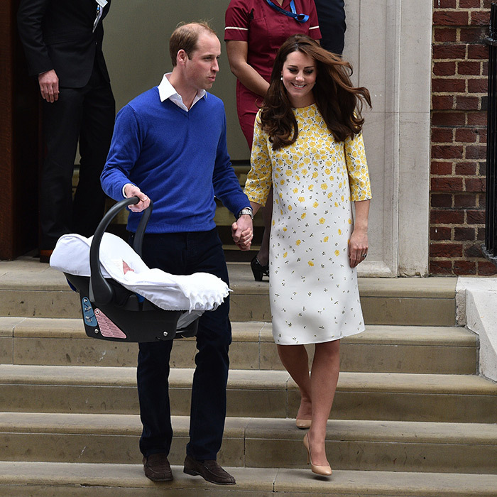 William and Kate – who again chose Jenny Packham for her dress for leaving the hospital – looked thrilled as they walked down the steps of the Lindo Wing hand in hand with their new baby in tow.