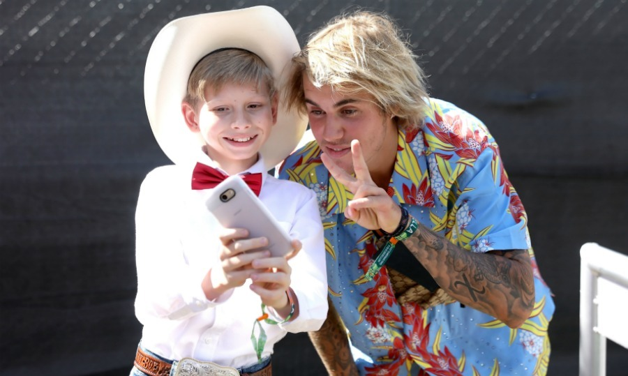 "<p>Past and present viral internet sensations! Mason Ramsey (aka The Walmart Yodeling Boy) and Justin Bieber pose for a selfie backstage during the 2018 Coachella Festival at the Empire Polo Field. The Biebs was seen cheering on 11-year-old Mason Ramsey as he gave a surprise performance during DJ Whethan's set. The child went viral back in April with a video showing him performing Hank Williams' ""Lovesick Blues"" at his local Walmart in Illinois. Justin, a former Youtube star himself, had predicated the kid would wind up at the festival.</p>