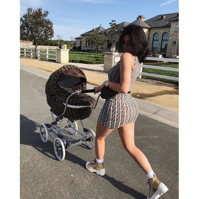 You may recognize the print Kylie Jenner was wearing while walking daughter Stormi through her neighbourhood. The 20-year-old was outfitted in a Fendi logo'd mini dress that matched her baby girl's stroller, which is made for order and costs $12,500.</p>
