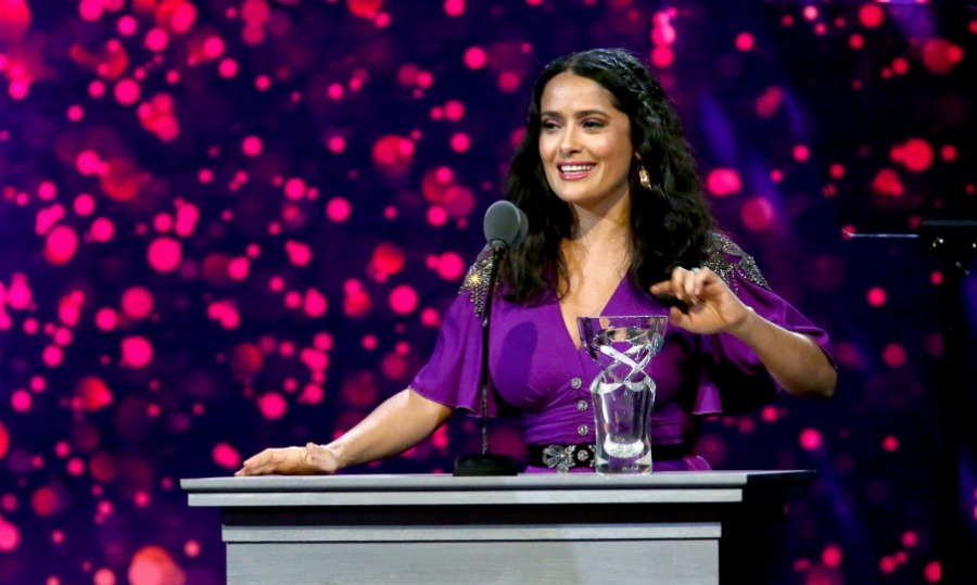 <p>Looking as dazzling as the shiny award she received, Salma Hayek sparkled while being honored at the star-studded seventh biennial UNICEF Ball. The 51-year-old actress seemed thrilled to be given the Danny Kaye Humanitarian Award while at the Beverly Wilshire Hotel in L.A. on the evening of Saturday, April 14. </p>