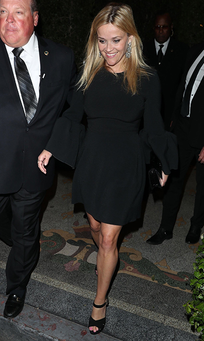 <p><em>Big Little Lies</em> star Reese Witherspoon showed off her megawatt smile while arriving at the party! The mother of three, who's currently filming the TV show's second season, dazzled in a black mini dress and matching pumps.</p>