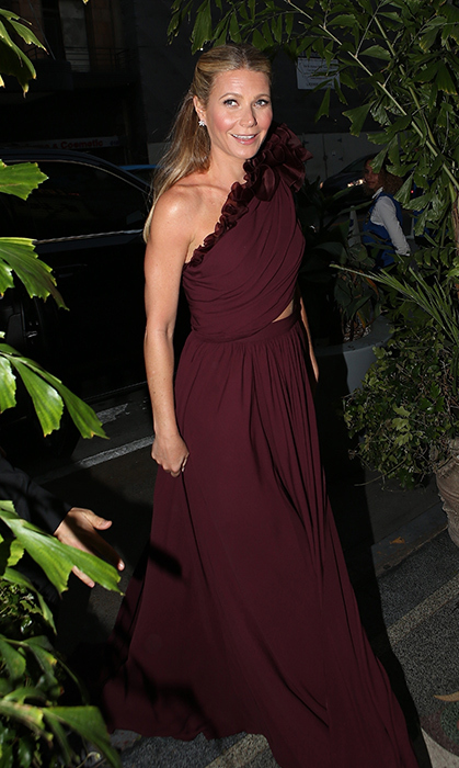<p>The woman of the hour! Gwyneth showed off her bachelorette weekend tan, courtesy of Mexico, in an ethereal maroon ruffled gown. Showing just the right amount of skin, the star let her natural beauty shine while celebrating a new chapter in her life.</p>