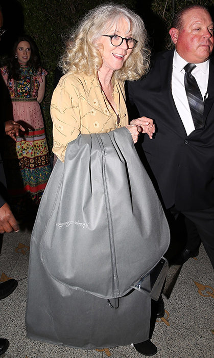 <p>Mom was in the house... carrying a bridal garment bag! Gwyneth's mother Blythe Danner was happy as a clam leaving the big party, but the bag in question has left many questioning if this engagement fete was <em>actually</em> a secret wedding.</p>