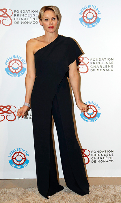 <p>Elegant as ever, Princess Charlene dazzled in a black one shoulder jumpsuit while attending a gala dinner prior to prior to the second edition of the Riviera Water Bike Challenge on Apr. 14.</p>