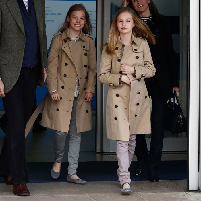 <p>Queen Sofía's granddaughters were twinning in British fashion wearing Burberry trench coats to visit their grandfather King Juan Carlos I at the hospital on Apr. 8. The stylish sisters were joined by their parents and paternal grandmother for the outing, one week after the royal family's viral Easter video.</p>