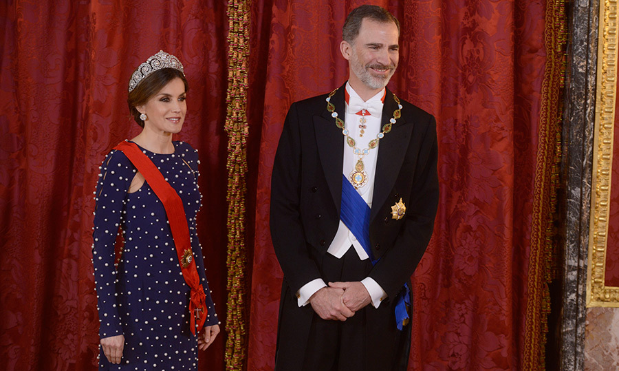 <p>Queen Letizia stunned in a navy gown, adorned with pearls, while hosting the special dinner with King Felipe VI. The gala was held for the President of Portugal Marcelo Rebelo de Sousa at the Royal Palace on Apr. 16.</p>