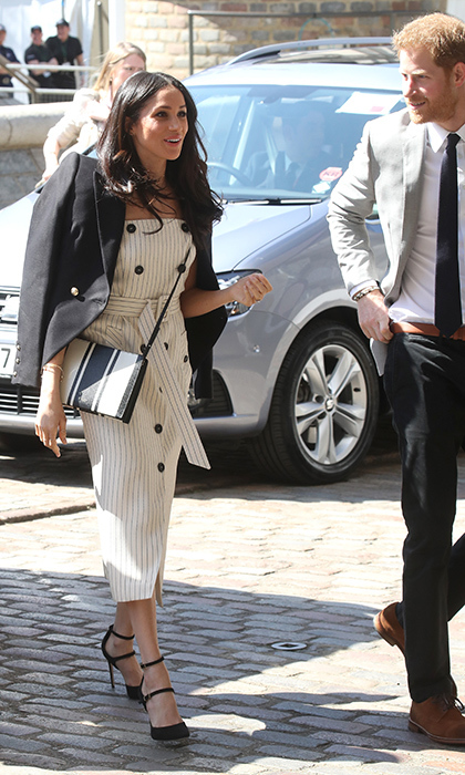 <p>Meghan was the picture of cool in this black-and-white nautical ensemble. The royal couple was beaming as they arrived at the event.</p>