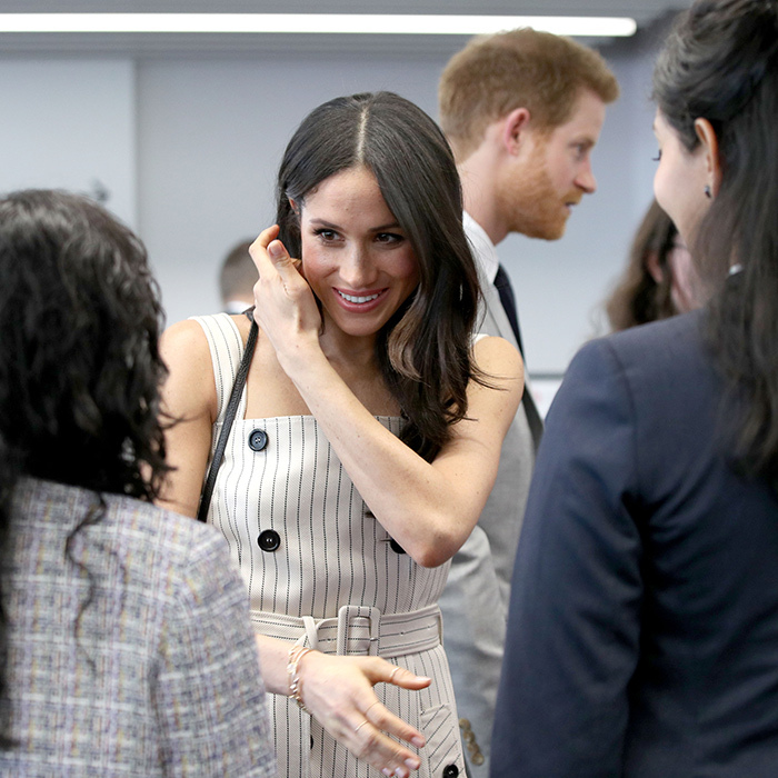 <p>Meghan graciously chatted with young delegates at the event.</p>