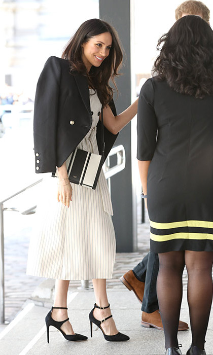 <p>The 36-year-old looked stylish as ever in a stunning striped cream dress by Altuzarra, a black blazer by Camilla and Marc, a black-and-white striped bag by Oroton and matching black Tamara Mellon's Paramour heels. To accessorize, Meghan went with Birks bar earrings and Natalie Marie rings. Harry looked smart in a tailored grey jacket and crisp white shirt combination.</p>