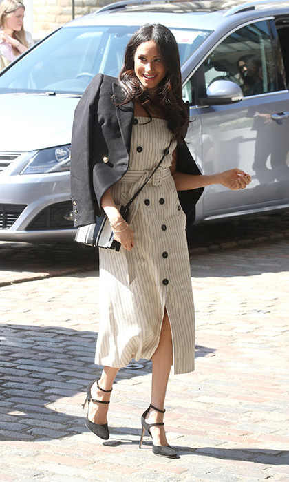 <p>The <em>Suits</em> alum oozed nautical cool in a stunning striped cream dress by <strong>Altuzarra</strong>, a black blazer by <strong>Camilla and Marc</strong>, a black and white striped <strong>Oroton</strong> bad (which retails at $306) and matching black Tamara Mellon Paramour heels. To accessorize, Meghan donned Birks earrings and Natalie Marie rings.</p>