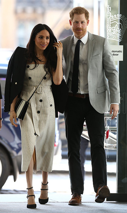 Meghan paired her accessories with an Altuzarra dress, Camilla and Marc blazer, Tamara Mellon heels and an Oroton bag.
